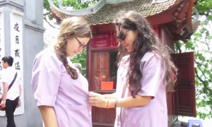 Hanoi's famous temple requires tourists to wear extra clothes